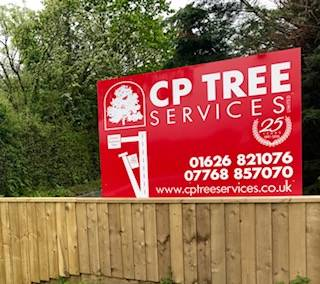 cp tree services sign ontop of new fence